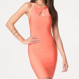 Bebe orange/peach color bandage style dress